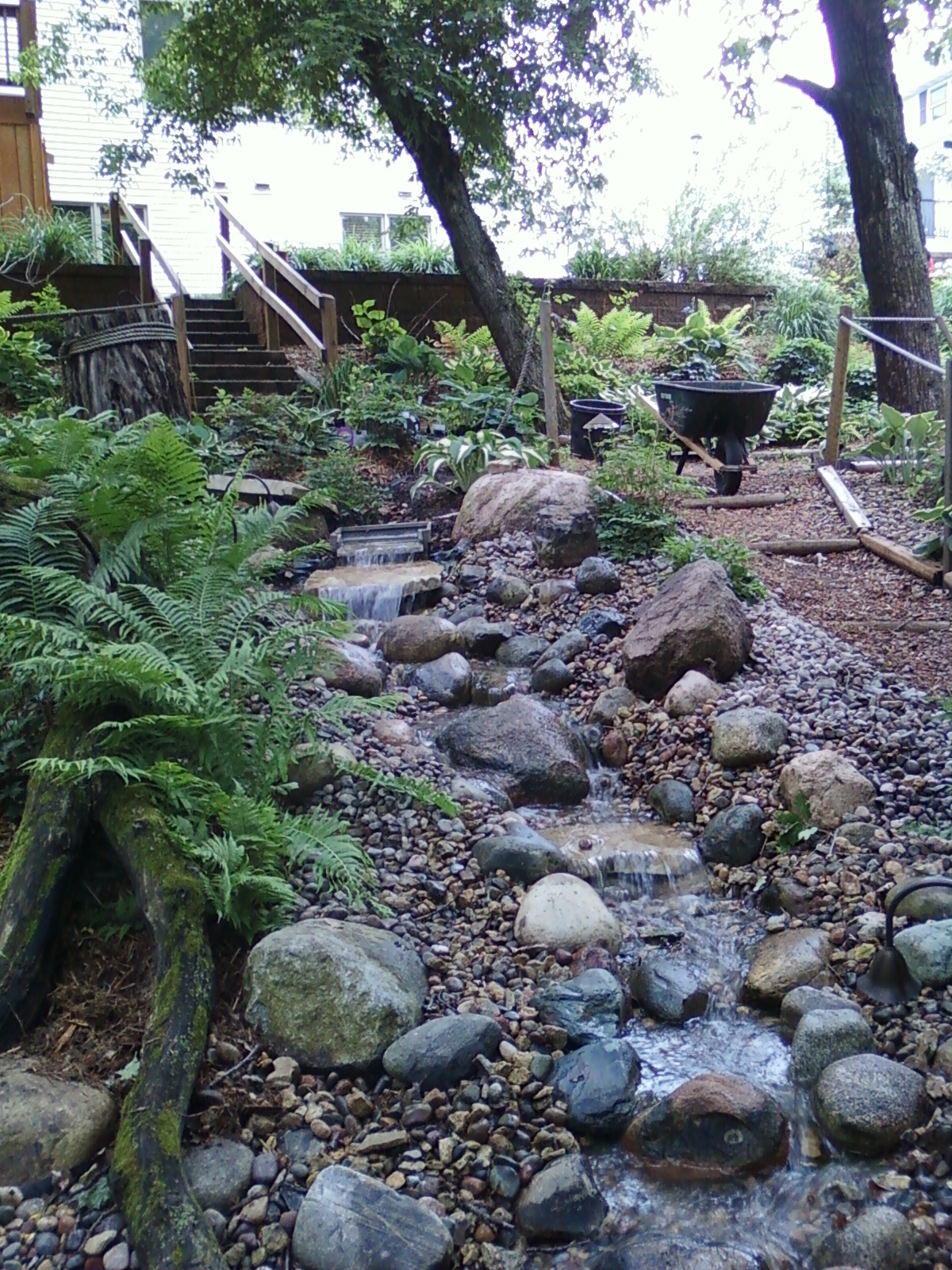 pondless stream with crushed rock pathways and landscaping