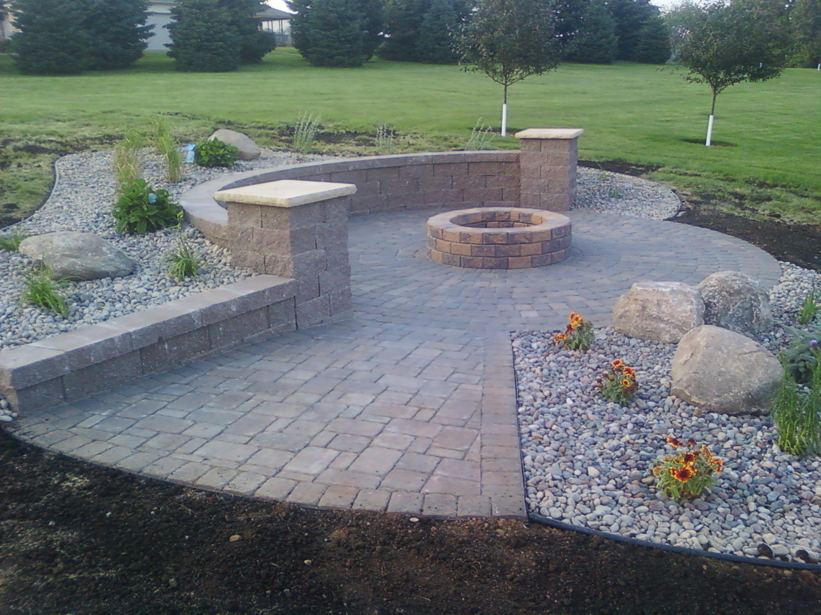 Patio and firepit with sitting wall RockSolidLandscape